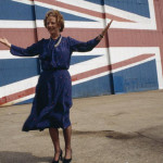 Margaret THATCHER launching the Conservative Party manifesto. In front of the largest Union Jack. 1983.